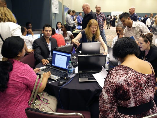 In this Sept. 10, 2014 photo, job seekers create resumes at the NJ Department of Labor's resume clinic in the Atlantic City Convention Center in Atlantic City, N.J.  Ten U.S. states still have not regained all the jobs they lost in the Great Recession, even after six and a half years of recovery, while many more have seen only modest gains. New Jersey has nearly 1 percent fewer jobs than it did at the end of 2007, and Missouri is just below its pre-recession level.