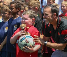 University of Louisville men's soccer team brings joy to 6-year-old boy with brain cancer