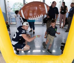 Sharing smiles, Penn State football brings fun to sick children