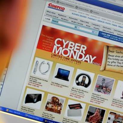 "An office worker looks at Cyber Monday specials on the Costco website Nov. 28, 2011, in New York. Consumers were likely to continue the Black Friday trend on Monday, known as ""Cyber Monday"" for the deep discounts offered on Internet retail sites."