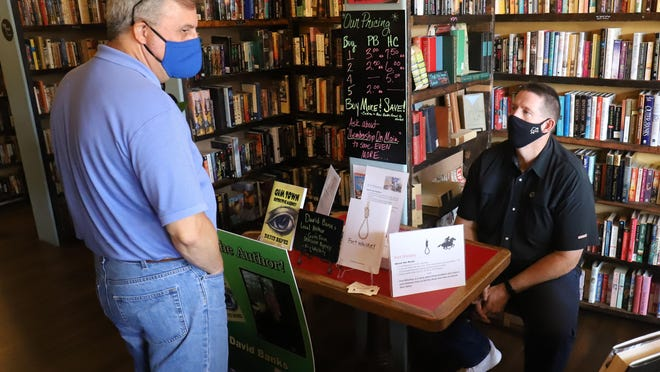 Dave Bailey, left, talks with Alma author David Bands, Saturday, Aug. 29, at Van Buren's Chapters On Main Bookstore during the Independent Bookstore Day event. Author Sidney Thompson is scheduled for his book signing on Friday, Sept. 4, 2020.