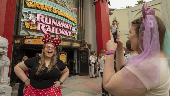Many guests dressed in Mickey- and Minnie-themed attire visited Disney's Hollywood Studios on March 4 for the opening day of Mickey & Minnie's Runaway Railway. The family-friendly new adventure at Walt Disney World Resort is the first ride-through attraction in a Disney park starring Mickey Mouse and Minnie Mouse.