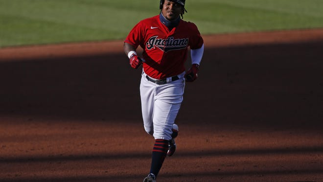 Cleveland Indians' Jose Ramirez runs the bases after hitting a solo home run off Cincinnati Reds starting pitcher Luis Castillo during the first inning of a baseball game at Progressive Field, Thursday, Aug. 6, 2020, in Cleveland.