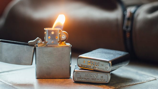 Zippo lighters are displayed in this file photo.