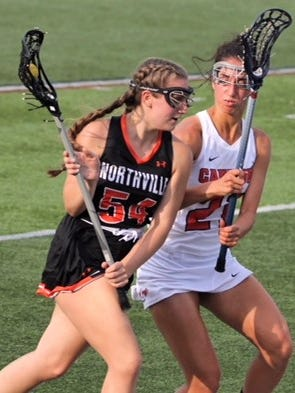 Northville's Katie Coomes (left) tries to dodge Canton's Katelyn Waligora.