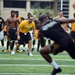 Southern Miss head strength and conditioning coach, Zac Woodfin, works with the football team during drills Thursday morning at M.M. Roberts Stadium. The USM football team is preparing offseason as they get closer to their first game on Sept. 5 against Mississippi State.