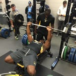 Former Southern Miss offensive lineman Norman Price bench presses during the school's pro day Thursday.