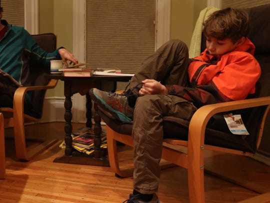 Linden Burack, 12, hangs out with his father, Richard,