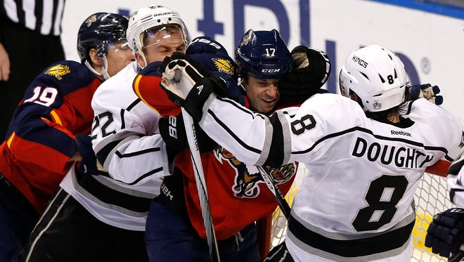 Florida Panthers center Derek MacKenzie and right wing Scottie Upshall battle with Los Angeles Kings defenseman Drew Doughty and center Trevor Lewis in the second period.