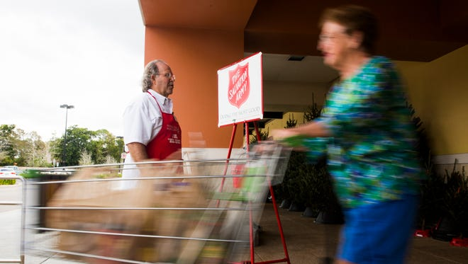 David Deciantis, a Salvation Army bell ringer, wishes each passer-by a good day on Monday, Nov. 28, 2016, at Publix at Kings Lake Square in East Naples. The Red Kettle Christmas Campaign provides food, clothing and toys to families in need during the holiday season.