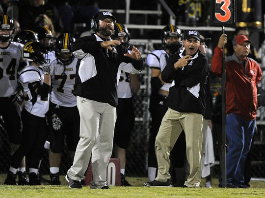 Cisco defensive coordinator Brad Brunson (left) and head coach Brent West (right) call a play during the third quarter of Cisco's 27-14 win on Friday, Nov. 4, 2016, at Maverick Stadium in Eastland.