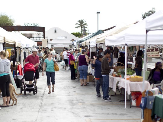 Shoppers browse Scottsdale's Old Town Farmers Market.