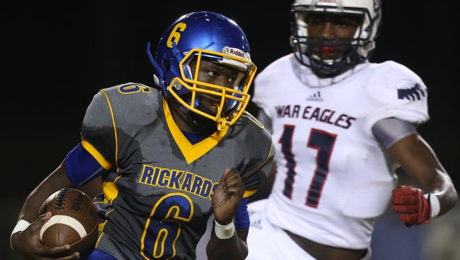 Rickards' Ferante Cowart runs the ball during their game against Wakulla at Cox Stadium on Thursday night.