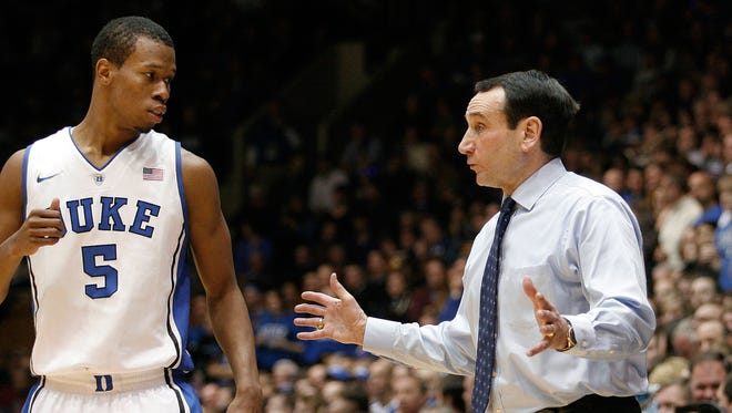 Duke Blue Devils head coach Mike Krzyzewski talks to Duke Blue Devils forward Rodney Hood (5) on the sidelines against the Florida State Seminoles at Cameron Indoor Stadium.
