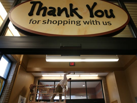 Gary Broadwell paints in the entrance of the new Perinton, Wegmans.  Renovations of the Perinton store, added 31,300 square feet, a new pub, and new prepared food area. Wegmans will celebrate the completed project on Saturday.