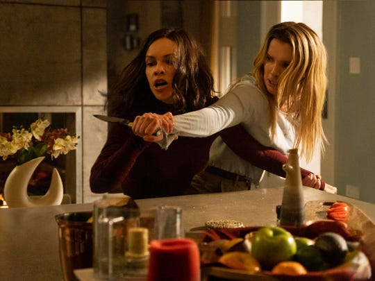 """Hilary Swank, left, and Betty Gilpin in """"The Hunt."""""""