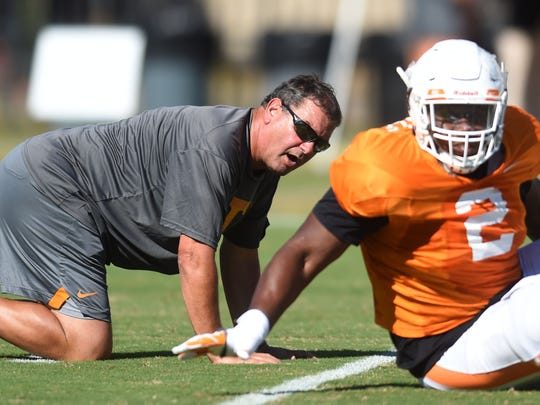 Tennessee Associate Head Coach and Defensive Line Coach Brady Hoke runs a drill with Tennessee defensive lineman Shy Tuttle (2) during a University of Tennessee fall football practice at Anderson Training Facility in Knoxville, Tenn. on Thursday, Aug. 24, 2017.