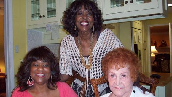 Jewell McMahan (right) sits with Ella Gaston's daughters, Voncille (left) and Jean (middle).