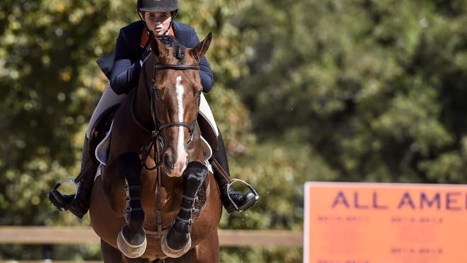 Hayley Iannotti, a three-time National Collegiate Equestrian Association national champion, is the lead trainer and an instructor at Carriage Hill Farms riding school in Delray Beach, where she learned her skills and passion for the sport 10 years ago.