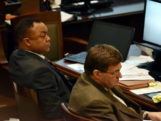 Hinds County District Attorney Robert Smith sits with