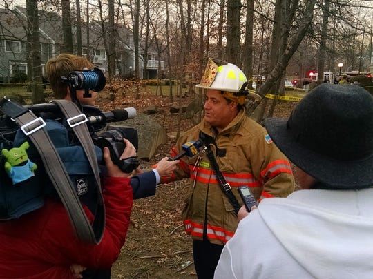 Kendall Park Fire Chief Chris Perez speaks to the media Friday afternoon while his company puts out a fatal condo fire at 27 Deerberry Lane in South Brunswick.