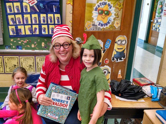 Three Bridges School enrichment teacher Dr. Joyce McGibbon dressed as Waldo, from the popular Where's Waldo? series, and Kindergartner Rhys Fort dressed as Peter Pan for Read Across America Day.