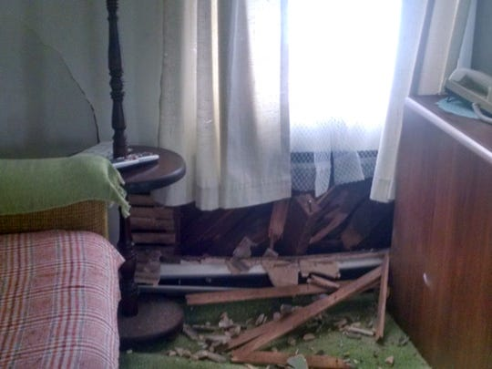 A Ridge Road home was damaged when a car ran off the road and struck the home Tuesday morning.