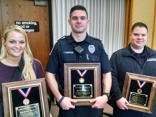 Dispatcher Jessica Vanliew, Officer Jarrid Harpster and Dispatcher John Muccioli were among those awarded the Life Saving Medal at South Brunswick police department's awards luncheon.