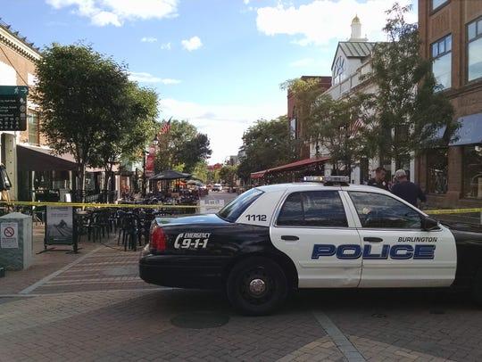 A Burlington police patrol car is parked on Church
