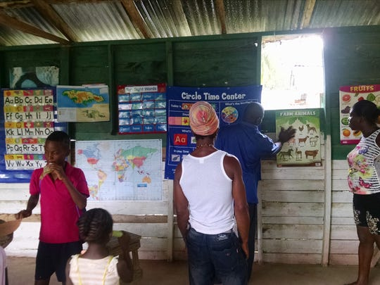 Teachers and students at a basic school (ages 3-6) in Roaring River, Jamaica.