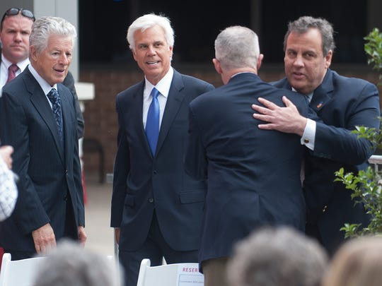 From left, former Governor, James Florio, George E. Norcross III, Governor Chris Christie, and former Governor, Jim McGreevey, interact during a name building dedication Cooper Sheridan Pavilion  in honor of late CEO John Sheridan and his Joyce.