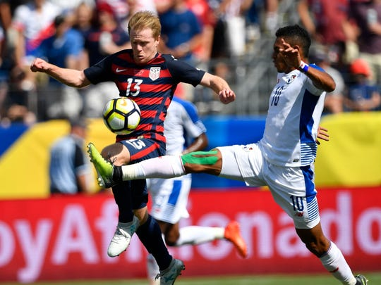 United States midfielder Dax McCarty (13) and Panama forward Ismael Diaz (10) battle for the ball during the first half of a CONCACAF Gold Cup soccer game at Nissan Stadium Saturday, July 8, 2017, in Nashville, Tenn.