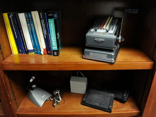Antique relics of Davis Kinard & Company's past are displayed on a bookshelf.