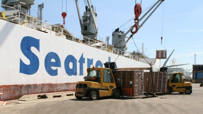 A Chilean fruit ship unloads cargo at the Port of Wilmington.