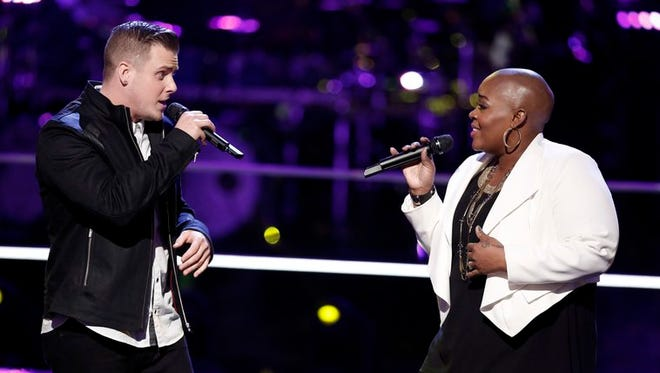 """James McNeiece, left, competed against Tonya Boyd-Cannon on Monday's episode of """"The Voice."""""""