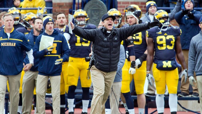 Michigan head coach Jim Harbaugh reacts on the sideline after a Michigan penalty in the first quarter of an NCAA college football game against Ohio State in Ann Arbor, Mich., Saturday, Nov. 28, 2015.
