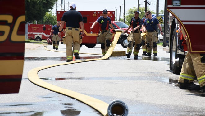 Sherman Fire-Rescue crews try to keep cool while working in triple-digit heat conditions in 2019. The National Weather Service in Fort Worth said the Texoma area will see a heat index of at least 100 degrees this weekend, but a dry front will bring temperatures back into the 90s by next week.