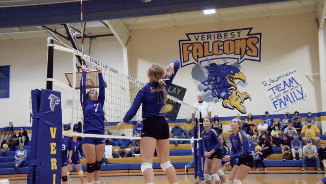Veribest Lady Falcon, Kennadi Wheeless (#1), prepares to spike the ball as Olfen's Desiree Medina defends at the net.