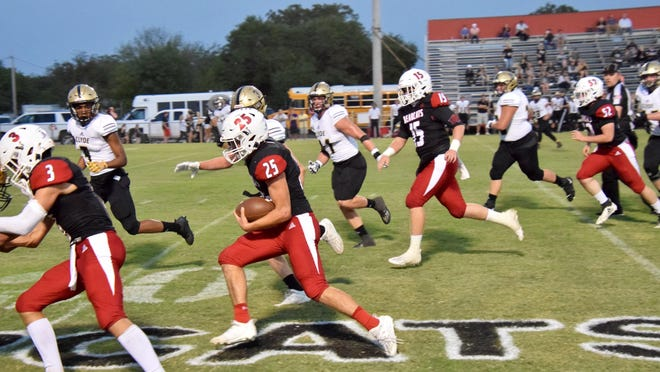 The Ballinger Bearcats' Garrett Dixon rushes the ball with a cadre' of blockers clearing the way. This week the unbeaten Bearcats will travel to Llano to take on the 4-0 Yellowjackets.