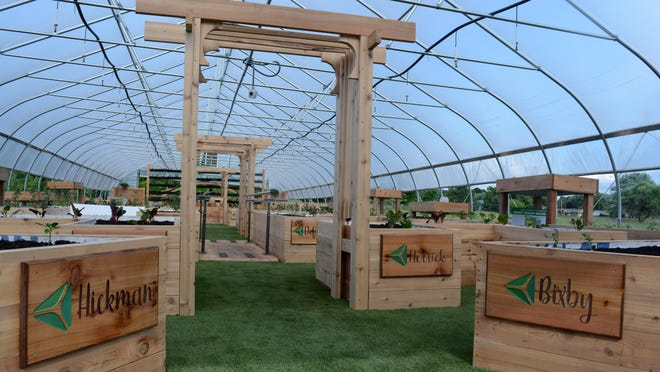 The hoop house at ProMedica Farms on the campus of the soon-to-open ProMedica Charles and Virginia Hickman Hospital in Adrian Township is pictured in June 2018. ProMedica Farms has been awarded a grant worth more than $400,000 from the Michigan Health Endowment Fund. The grant  will support and expand the farm's programs to provide a new living laboratory for youth, seniors and families; a therapeutic healing space for patients and staff of Hickman Hospital; as well as fresh, locally grown food to the Lenawee County community.