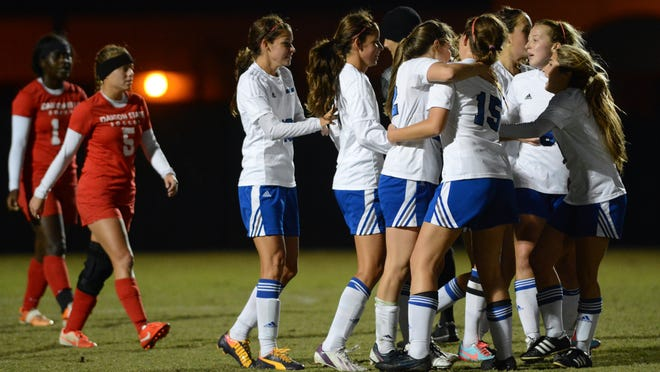 Eastern Florida State players celebrate a goal against Darton State in the NJCAA Division I Women's Soccer National Championship Tournament.