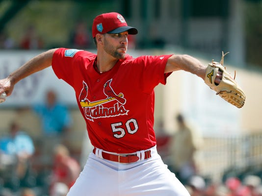 St. Louis Cardinals starting pitcher Adam Wainwright throws during the first inning of an exhibition spring training baseball game against the Minnesota Twins Thursday, March 1, 2018, in Jupiter, Fla. (AP Photo/Jeff Roberson)