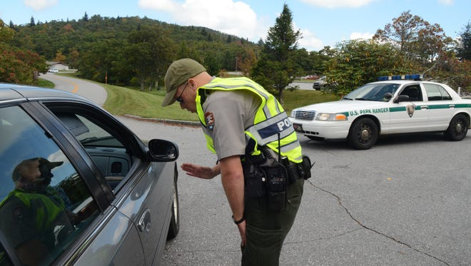 Park Ranger Joseph Darling directs visitors away from Pisgah Inn on the Blue Ridge Parkway on Oct. 4, 2013, after the privately run inn that operates on public land opened for lunch.