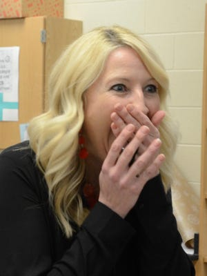 Novi Middle School teacher Sarah David reacts to being named district Teacher of the Year.