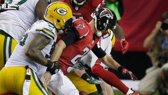 Green Bay Packers outside linebacker Julius Peppers stops  Atlanta Falcons quarterback Matt Ryan in a game earlier this season.