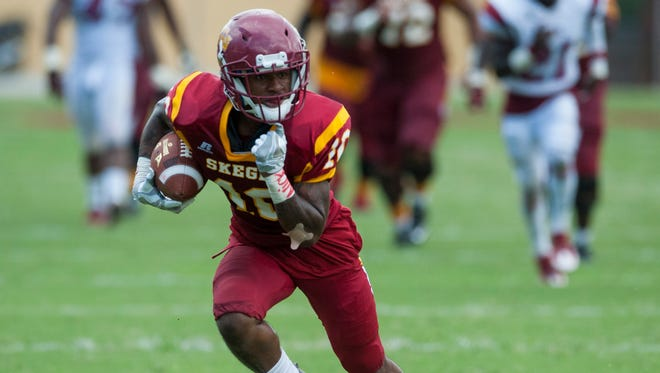 Tuskegee's Desmond Reece breaks free for a touchdown against Lane College in Tuskegee, Ala., on Saturday September 24, 2016.