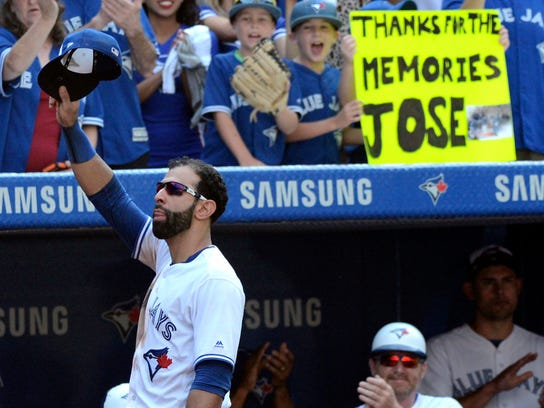Toronto Blue Jays' Jose Bautista acknowledges the crowd after leaving a baseball game against the New York Yankees during the ninth inning Sunday, Sept. 24, 2017, in Toronto. (Jon Blacker/The Canadian Press via AP)