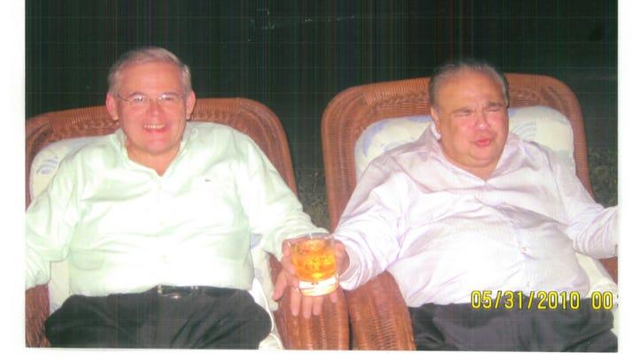 U.S. Sen. Bob Menendez, left, lounges next to Salomon