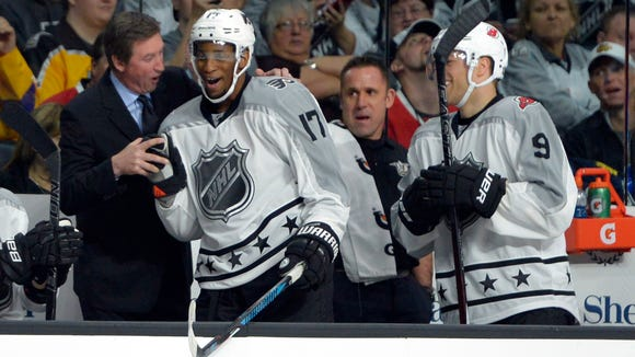 Wayne Simmonds, middle, was the MVP of Sunday's NHL All-Star Game and coached by Wayne Gretzky, left.
