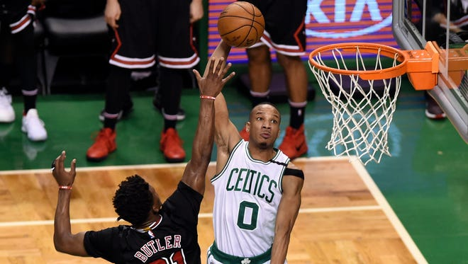 Boston Celtics guard Avery Bradley (0) goes to the basket past Chicago Bulls forward Jimmy Butler (21) during the second half in game five of the first round of the 2017 NBA Playoffs at TD Garden.